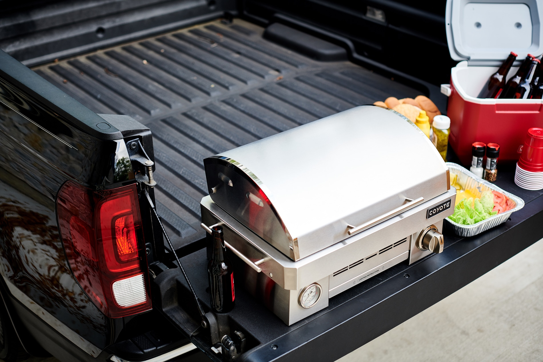 Coyote Outdoor Portable Grill in Truck Bed